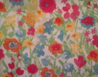 Double kitchen towel extra wide with multi colored flowers. Crocheted yellow top.