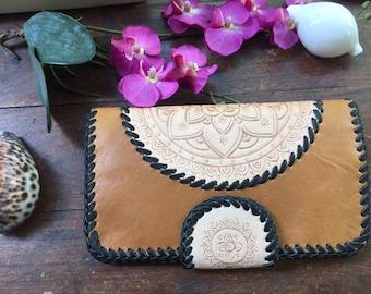 Tan leather mandala wallet.