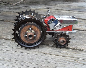 Welded tractor sculpture of salvaged materials for indoors or out.