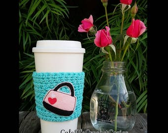 Crochet coffee cup cozy, with a handbag feltie, made with 100% cotton. Crochet coffee sleeve, crochet coffee cozie