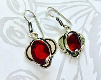Red garnet in .925 sterling silver.