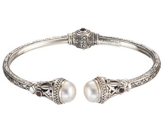 cuff bracelet in sterling silver with freshwater pearls and garnets, Gerochristo Santorini bracelet