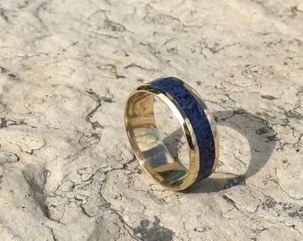 Brass inlaid with Lapis Lazuli. Stone inlay, glowring.  In sizes 6-13