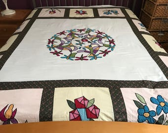 Machine Applique Dragonfly with flowers quilt top