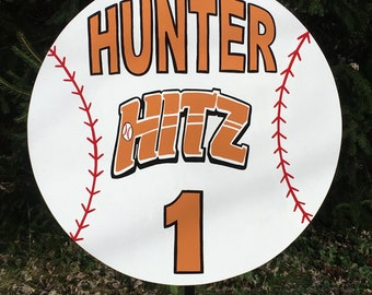 "Baseball personalized sports yard sign.  Personalized with name, number and team logo.  Sign 23""  is attached to a 42"" metal t bar stake."