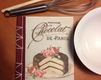 Recipe book bound by hand from recycled paper