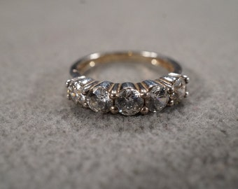 vintage sterling silver band ring with five large round faceted prong-set cubic zirconia stones, size 5  M3