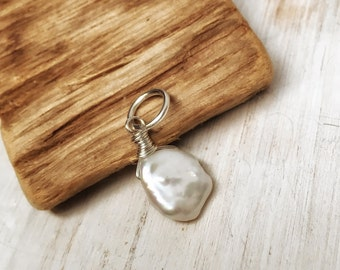 Freshwater keshi pearl - single white pearl charm wire wrapped in sterling silver