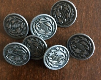 7 Antique metal buttons with a pewter finish aluminium back abstract leaf design French estate sale.