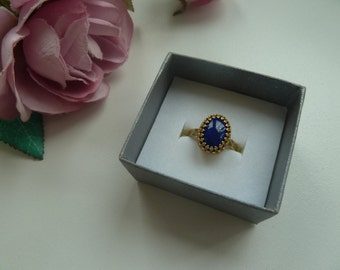 Brass gallery wire ring with lapis lazuli