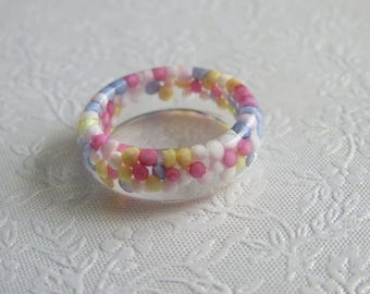 Resin ring with hundreds and thousands. Approximately UK I 1/2 or US 4 1/2