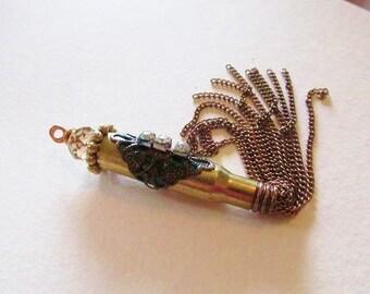 Hot hot hot. Embellished bullet casing pendent