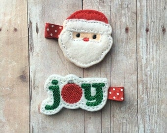 2 Christmas themed clips - partially lined alligator clips with no slip grip - Santa and joy
