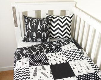 Monochrome black and white patchwork nursery items (black arrow quilt backing)