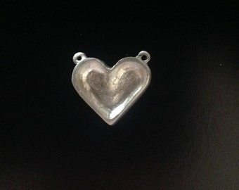 Heart It. A small, sterling silver heart bezel.