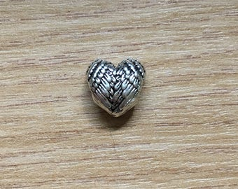 Heart shaped wings charm bead, silvercoloured