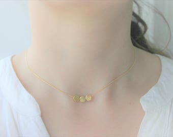 Necklace gold plated more three round pieces