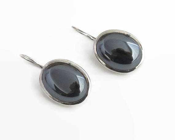 Sterling silver and hematite drop earrings with large dark grey stones, hook and c-clasp closure, stamped 925, 15 grams, circa 1970s
