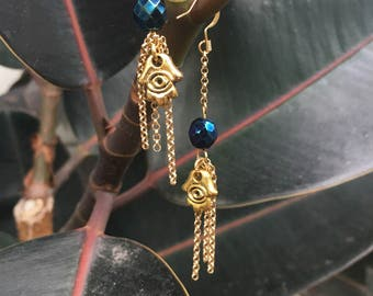 Gold hamsa hand dangling earrings with chain fringe