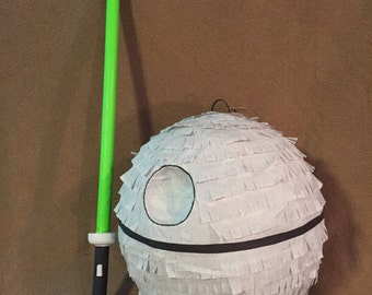 Death star pinata with light saber