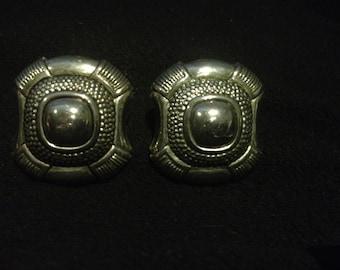 Large metal statement piece earrings
