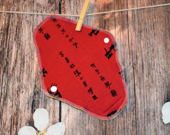9.5″ Medium Pad – Regular to Moderate Flow – Writing on Red Jersey