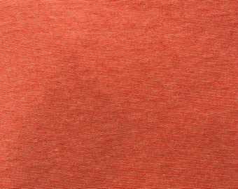 Rust colored knit fabric