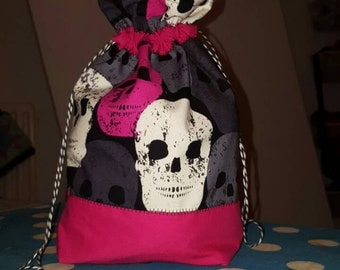 Small bag with skulls. Knitting project bag with skulls.