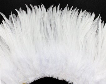 Wholesale 1/2 Yard, Strung Rooster White Saddle Feathers (5-7 inches in length) for Crafting, Sewing, Wedding, Decoration SKU: 7A33