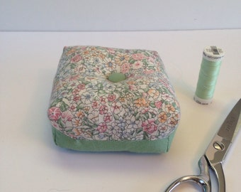 Square, box shaped green and floral print pincushion, pin holder