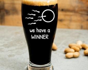 We have a winner Pregnant Funny Wine Glass (or stemless), Pint Glass, Pilsner, Mason Jar, Beer Stein or Coffee & Tea Mug