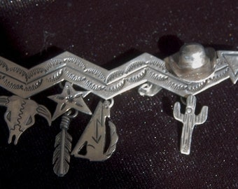 Vintage Native American sterling silver pin/brooch, cowboys and Indians
