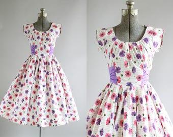 Vintage 1950s Dress / 50s Cotton Dress / Purple and Pink Floral Print Dress w/ Purple Waist Sash XS