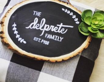 """custom sign for home-hand-lettered wooden slice - """"family name, est"""""""