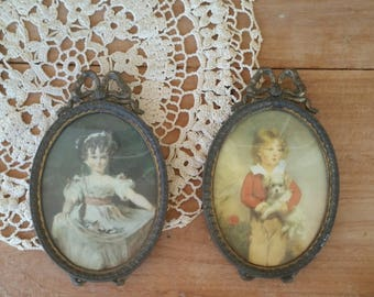 Two Lovely old vintage brass cameo medallions / boy and girl/miniatures ready to hang/ so cute