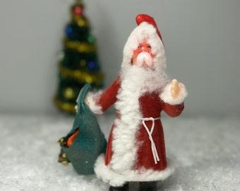 vintage plastic Christmas ornament Santa with toy bag