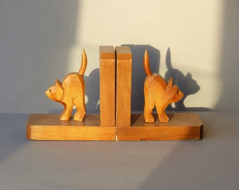 Set of 2 bookends, cats, wood, handcarved, German Black Forest, fifties, sixties, dark brown with glass eyes