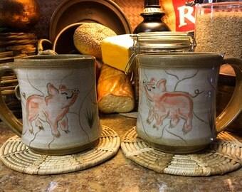 A Pair of Ceramic Handmade Pig Mugs