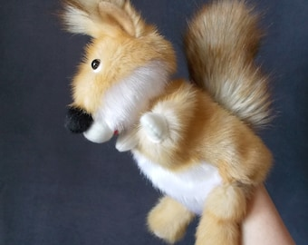 Squirrel.  Bibabo. Toy glove. Marionette. Puppet. Toy on hand. Puppet theatre.