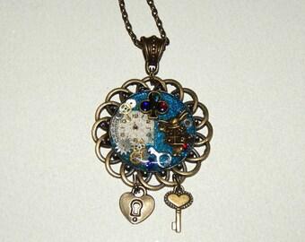 Alice in Wonderland, Steampunk Pendant, Blue, Art  Glitter Necklace, clock face, Lock, Key, Jewelry, Resin, vintage  watch parts #et 608