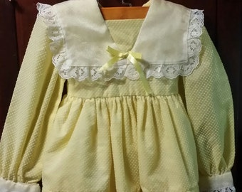 An adorable little girl yellow vintage 1960's dress.