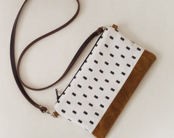 Printed canvas crossbody bag with leather straps
