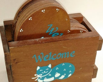 Wooden Crate With 6 Heart Shaped Coasters With A Blue And White Cat On The Front/Welcome/Great Used Condtion (P)