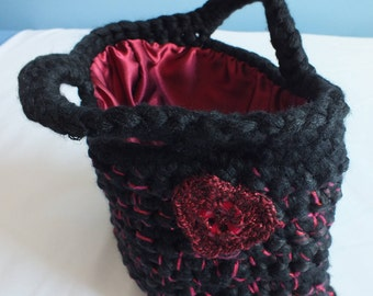 Handbag - crocheted with super chunky yarn, sequinned yarn and ribbon - glittery yarn and button heart - red satin lining - black and red