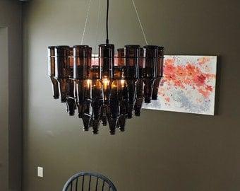 articles similaires lustre en bouteille orangina recycl es construit et suspendu raccords. Black Bedroom Furniture Sets. Home Design Ideas