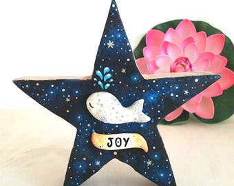 Whale in Free Standing Wooden Star With JOY Lettering Galaxy/Space Background. Handcrafted Mixed Media: Ceramics, Acrylic and Wood.