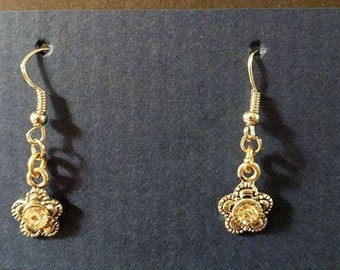 Silver flower with silver fishhook