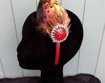 Fascinator,handmade,red satin hairband of pheasant feathers secured with a red brooch embellishment. One- off piece ~ Wedding ~ Races.