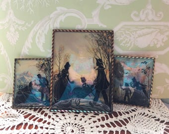Set of 3 beautiful glass silhouette art in matching frames