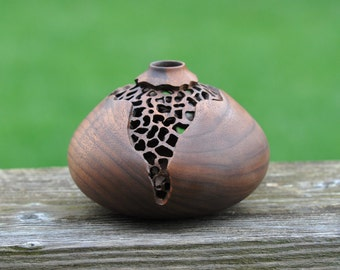 """320 Hand carved and pierced walnut hollow form (4.5"""" x 3.0"""")."""